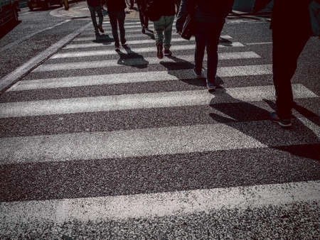 People crossing the crosswalk to go to work in japan