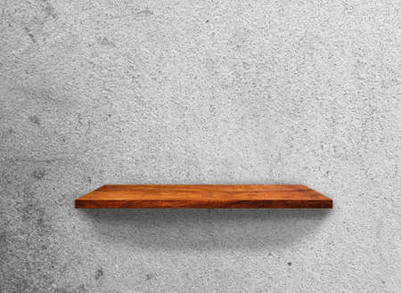 Vintage Wooden shelves on concrete wall texture background