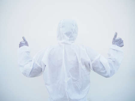 Asian male doctor or scientist in PPE suite uniform showing thumbs up with turn back. coronavirus or COVID-19 concept isolated white background Stock Photo