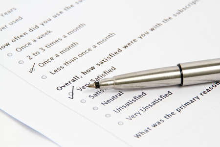 unsatisfactory: Pen Pointing at Survey and Questionnaire Form, business concept