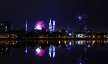 KUALA LUMPUR, MALAYSIA - JAN 1: A reflection of fireworks during the New Year 2011 celebrations near Malaysia landmark Petronas Twin Towers (KLCC) on January 1, 2011 in Kuala Lumpur Malaysia