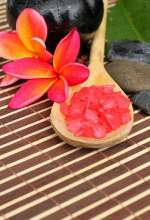 Spa Concept: Frangipani Flower, zen stone and crystal salt on bamboo mats  photo