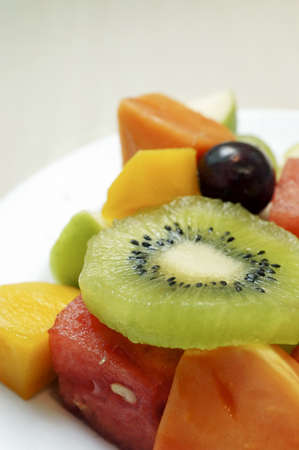 mixed fruits: Mixed slices fruits on a plate