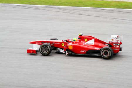 massa: SEPANG, MALAYSIA - APRIL 8: Ferraris driver Felipe Massa races down the track on practice day at the 2011 Petronas Malaysia Grand-Prix on April 8, 2011 in Sepang International Circuit, Malaysia Editorial
