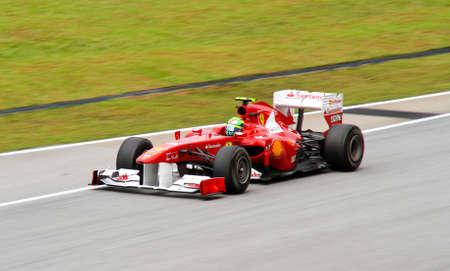 seater: SEPANG, MALAYSIA - APRIL 8: Ferraris driver Felipe Massa races down the track on practice day at the 2011 Petronas Malaysia Grand-Prix on April 8, 2011 in Sepang International Circuit, Malaysia.