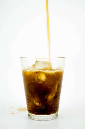 Glass of soda with ice cubes on white background 版權商用圖片