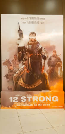 KUALA LUMPUR, MALAYSIA - JANUARY 17, 2018: 12 Strong The Declassified True Story of the Horse Soldiers movie poster,