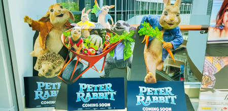 KUALA LUMPUR, MALAYSIA - MARCH 4, 2018: Peter Rabbit movie poster. Peter Rabbit is a 2018 3D Live-action/computer-animated comedy film directed by Will Gluck.