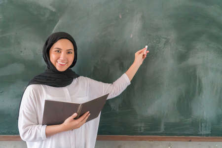 Malay School Teacher wearing hijab at the classroom