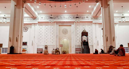 KUALA LUMPUR, MALAYSIA - AUGUST 25, 2018: Muslim performing prayers at Tengku Ampuan Jemaah Mosque, Bukit Jelutong Editorial