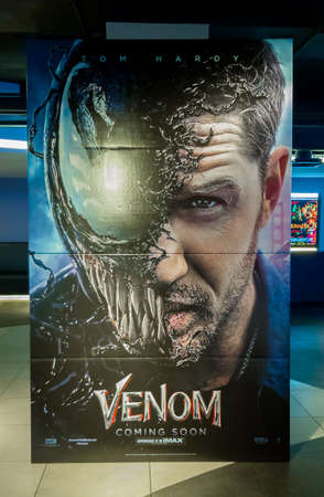 KUALA LUMPUR, MALAYSIA - SEPTEMBER 5, 2018: Venom movie poster, this movie is about Eddie Brock acquires the powers of a symbiote, and become Venom