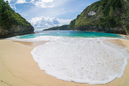 Crystal Clear water at Manta Bay or Kelingking Beach on Nusa Penida Island, Bali, Indonesia