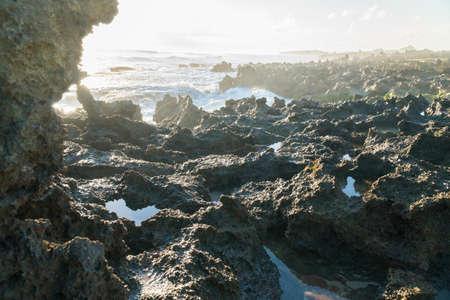 Pointy, Sharp Rocks and Beautiful sunset at Pantai Pero, Sumba Island, Indonesia 写真素材