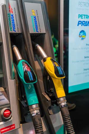 KUALA LUMPUR, MALAYSIA - NOVEMBER 23, 2018: Petronas Gas station pump with fuel nozzle