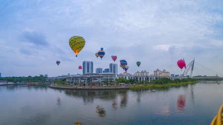 PUTRAJAYA, MALAYSIA - MARCH 29, 2019: The beautiful of multi shaped of hot air balloons floating over sunrise skies at the 10th Putrajaya International Hot Air Balloon Fiesta 2019