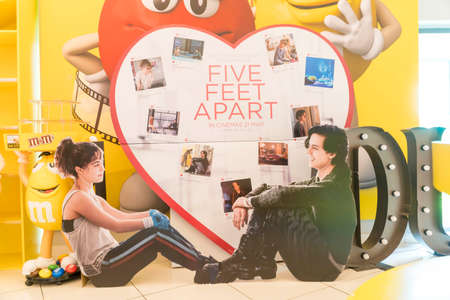 KUALA LUMPUR, MALAYSIA - APRIL 3, 2019: Five feet apart movie poster, is about a pair of teenagers with cystic fibrosis meet in a hospital and fall in love Editorial
