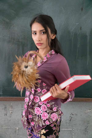 Beautiful Malay Teacher wearing traditional cloth at school