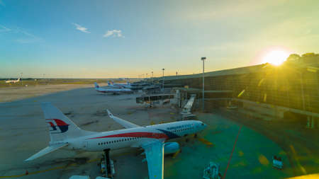 KUALA LUMPUR, MALAYSIA - MAY 6, 2019: Malaysia Airline commercial aircraft at KLIA airport during sunset 에디토리얼