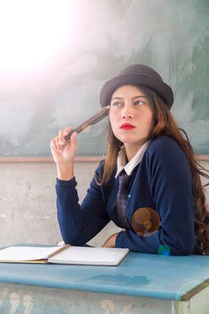 asian student at classroom thinking