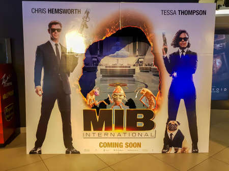 KUALA LUMPUR, MALAYSIA - MAY 21, 2019: Men in Black International movie poster. This movie is American science fiction action comedy film directed by F. Gary Gray