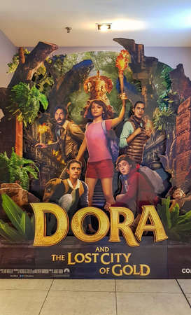 KUALA LUMPUR, MALAYSIA - JULY 4, 2019: Dora and the Lost City of Gold movie poster, is an American adventure film adaptation from television series Dora the Explorer Редакционное