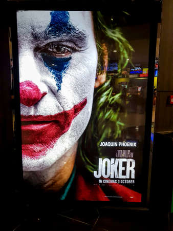 KUALA LUMPUR, MALAYSIA - OCTOBER 6, 2019: Joker movie poster, is a 2019 American psychological thriller film directed by Todd Phillips based on DC comics character starring Joaquin Phoenix Sajtókép
