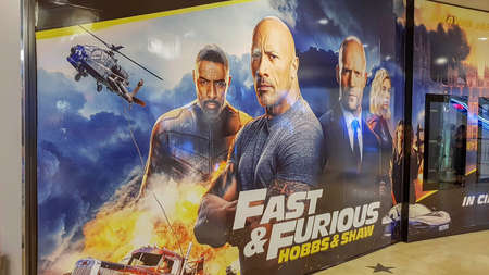 KUALA LUMPUR, MALAYSIA - JULY 26, 2019: Fast and Furious hobbs and shaw movie poster, is a spin-off of the Fast and the Furious franchise starring Dwayne Johnson and Jason Statham