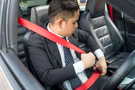 E-Hailing Concept, young asian man driving a car wearing seatbelt Stockfoto