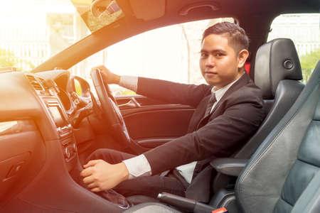 E-Hailing Concept, young asian man driving a car