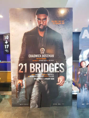 KUALA LUMPUR, MALAYSIA - JANUARY 8, 2020: 21 Bridges movie standee, is a 2019 American action thriller film directed by Brian Kirk.