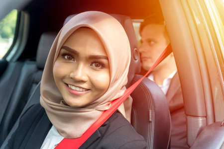 E-Hailing concept, young malay girl on the passenger seat looking thru window