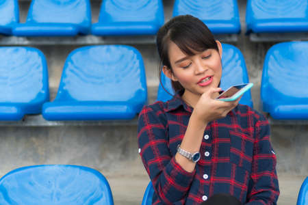 Student Lifestyle concept, cute asian girl using smartphone at the bench