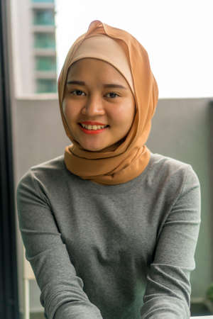 Portraiture of cute malay muslim wearing hijab outdoor Stock Photo