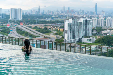 Travel Concept, Swimming pool on roof top with beautiful city view Kuala Lumpur malaysia