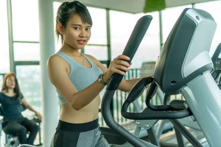 Healthy Concept, Cute Asian girl at the gym