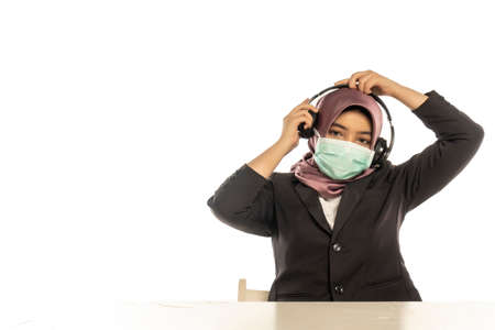 Business Lifestyle, Cute Malay Woman wearing hijab, face mask and headset
