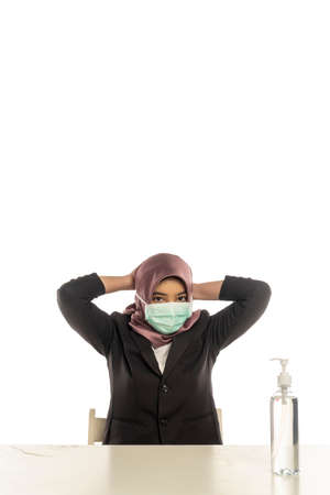 Business Lifestyle, Cute Malay Woman wearing hijab demonstrate how to use face mask