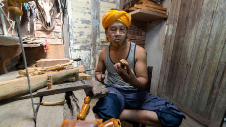Local demonstrate on making art of crafting Malay Traditional asymmetrical Dagger called