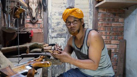 "Local demonstrate on making art of crafting Malay Traditional asymmetrical Dagger called ""Keris"""