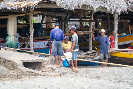 LAMALERA, NUSA TENGGARA, INDONESIA - DEC 13, 2018: The locals gather around for bot repairing at Lamalera, Indonesia