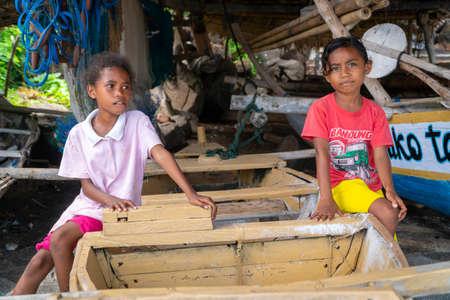 LAMALERA, NUSA TENGGARA, INDONESIA - DEC 13, 2018: Portrait of little little girl smiling at Lamalera Indonesia