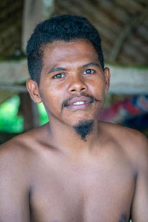 LAMALERA, NUSA TENGGARA, INDONESIA - DEC 13, 2018: Portrait of young adults male looking at the camera at lamalera, Indonesia