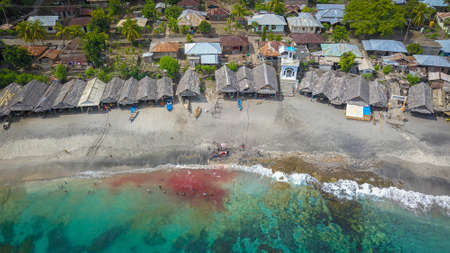 LAMALERA, NUSA TENGGARA, INDONESIA - DEC 13, 2018: Scenic view and Traditional hut at Lamalera, Nusa Tenggara, Indonesia. Lamalera is home of the Traditional Whale Hunting people Publikacyjne