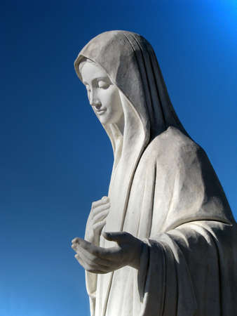 tabernacle: Heaven Calling. The marble statue of Our Lady Queen of Peace in the square of St James church in Medjugorje, Bosnia-Herzegovina Stock Photo