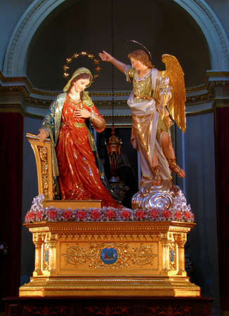 gabriel: The statue of The Annunciation of Our Lord Jesus to The Blessed Virgin Mary by the Angel Gabriel displayed in Tarxien, Malta  Editorial