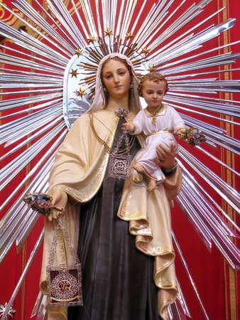lys: The statue of Our Lady of Mount Carmel in Fleur de Lys, Malta  Stock Photo