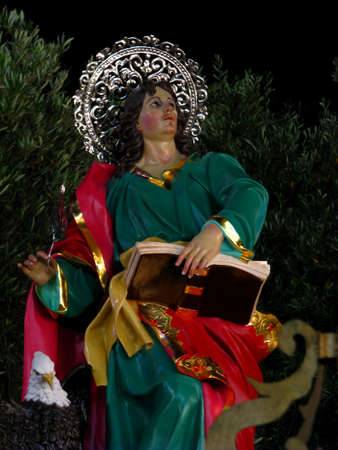 A decorative statue of Saint John the Evangelist embellishing the church square of Zebbug in Malta during the feast of Saint Philip