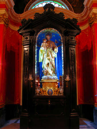 The statue of Saint Joseph in the niche in Zebbug, Malta  Editorial