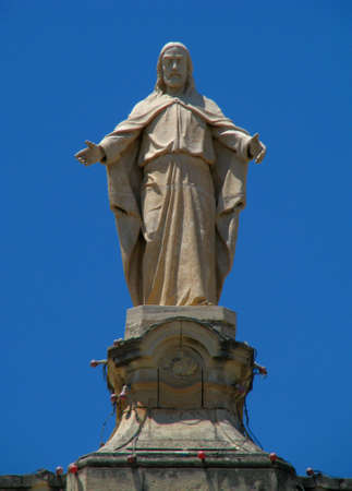 marsa: A statue of Our Lord Jesus high up on a church s rooftop in Marsa, Malta