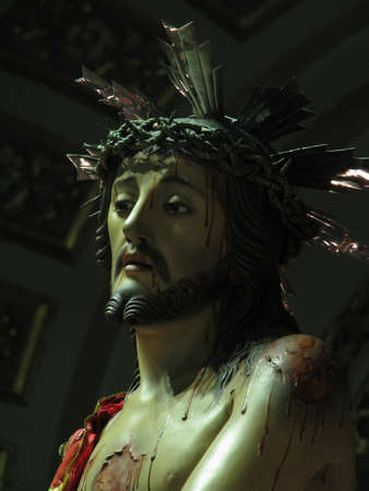 flagellation: A detail of a statue depicting Jesus being crowned with thorns in Cospicua, Malta. Stock Photo